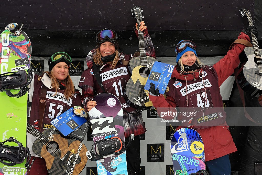 Isabel Derungs of Switzerland in third place, Jamie Anderson of the USA in first place and Kjersti Buaas of Norway in second place take the podium after for the ladies FIS Snowboard Slope Style World Cup at the US Grand Prix on January 11, 2013 in Copper Mountain, Colorado.