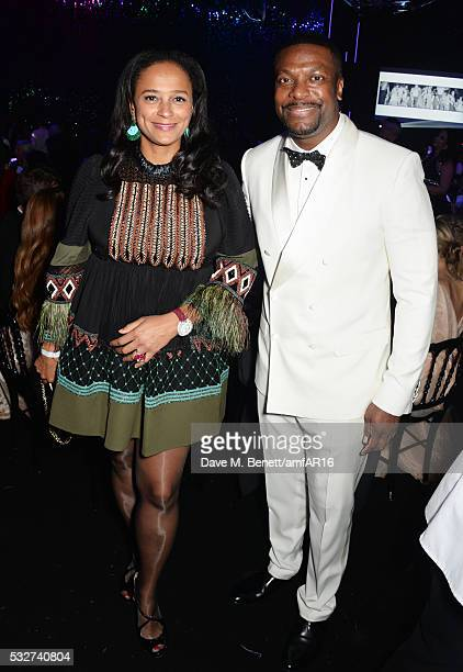 Isabel dos Santos and Chris Tucker attend amfAR's 23rd Cinema Against AIDS Gala at Hotel du CapEdenRoc on May 19 2016 in Cap d'Antibes France