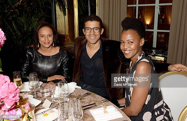 Isabel dos Santos Sindika Dokolo and Wangechi Mutu attend the Sindika Dokolo Art Foundation dinner at Cafe Royal on October 18 2014 in London England
