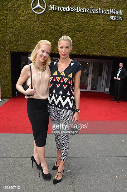 Isabel Edvardsson and Giulia Siegel attend the Glaw show during the MercedesBenz Fashion Week Spring/Summer 2015 at Erika Hess Eisstadion on July 9...