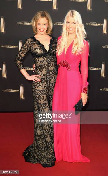 Isabel Edvardsson and Tina Kaiser arrive at the red carpet of the 'Deutscher Fernsehpreis 2013' at Coloneum on October 2 2013 in Cologne Germany