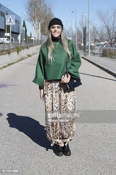 Isabel Garcia is wearing Zara Shoes Mango Pants Xavi Reyes Jersey and HM Hat at MercedesBenz Madrid Fashion Week Autumn/Winter 2016/2017 on February...