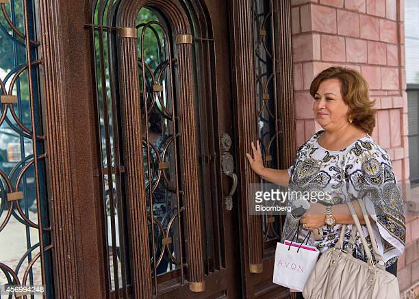Isabel Hernandez unit leader and independent sales representative for Avon Products Inc arrives to take an order from a customer in McAllen Texas US...