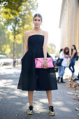 Isabel Jaime poses wearing a Yasya Minokina dress Moschino bag and Chanel shoes on the streets of Paris during Paris Fashion Week on October 1 2014...