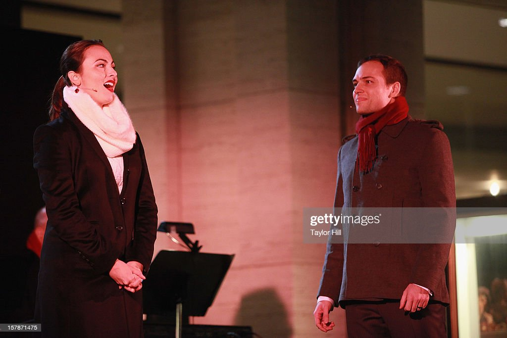 Isabel Leonard and Alek Shrader perform a selection from Offenbach's La Perichole at The Metropolitan Opera Tree Lighting Ceremony at The Metropolitan Opera House on December 6, 2012 in New York City.