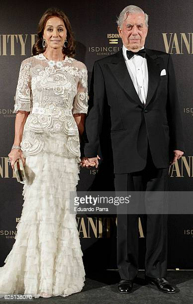 Isabel Preysler and writer Mario Vargas Llosa attend the 'Vanity Fair number 100 party' photocall at Real Academia de Bellas Artes de San Fernando on...