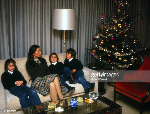 Isabel Preysler wife of Julio Iglesias at Christmas at her home in Madrid with her three children Cheveli Julio Jose and Enrique 23rd December 1979...