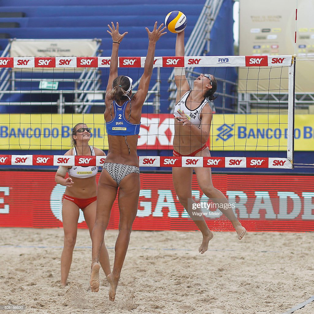Isabel Schneider and Teresa Mersmann of Germany in action during main draw match against Elize Maia of Brazil during the FIVB Fortaleza Open on Futuro Beach on April 29, 2016 in Fortaleza, Brazil.
