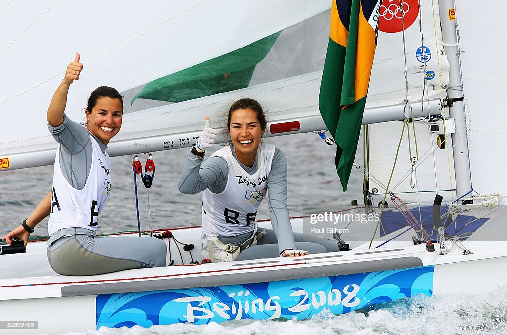 Isabel Swan and Fernanda Oliveira of Brazil celebrate after finishing third overall following the Women's 470 class medal race held at the Qingdao...