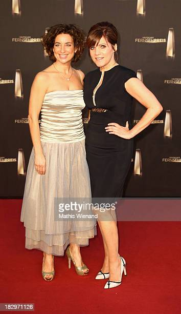 Isabel Varell and Birgit Schrowange arrive at the red carpet of the 'Deutscher Fernsehpreis 2013' at Coloneum on October 2 2013 in Cologne Germany