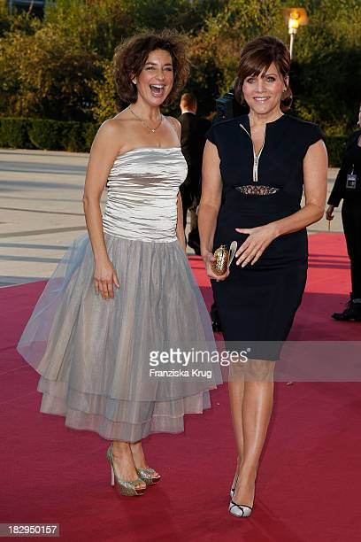 Isabel Varell and Birgit Schrowange attend the Deutscher Fernsehpreis 2013 Red Carpet Arrivals at Coloneum on October 02 2013 in Cologne Germany