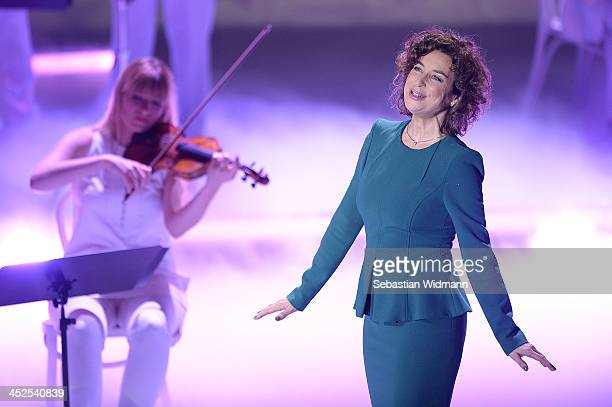 Isabel Varell performs during the 'Heiligabend mit Carmen Nebel' show taping at the Bavaria Studios on November 29 2013 in Munich Germany
