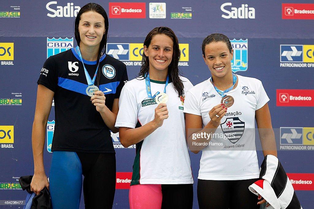 Isabela Bressan Fraioli, Giovanna Dorigon and Rafaeli Coutinho stands on the podium for girls 100m breaststroke Junior 1 during Julio Delamare Trophy at Botafogo Aquatic Park on December 07, 2013 in Rio de Janeiro, Brazil.