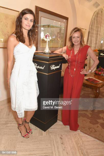 Isabeli Fontana and Caroline Scheufele pose with the Green Carpet Fashion Award as they attend an intimate lunch to announce Chopard as partner for...