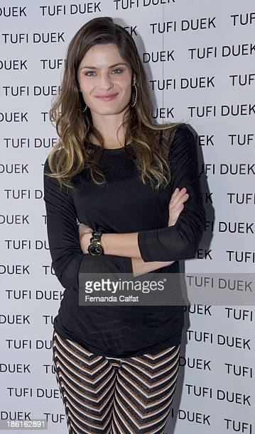 Isabeli Fontana attends front row at Tufi Duek show at Sao Paulo Fashion Week Winter 2014 on October 28 2013 in Sao Paulo Brazil