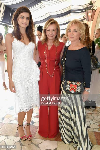 Isabeli Fontana Caroline Scheufele and Alberta Ferretti attend an intimate lunch hosted by Livia Firth Carlo Capasa and Caroline Scheufele to...