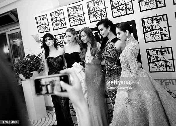 Isabeli Fontana Doutzen Kroes Azra Akin Megan Gale and Araya Hargate depart the Martinez Hotel during the 68th annual Cannes Film Festival on May 19...