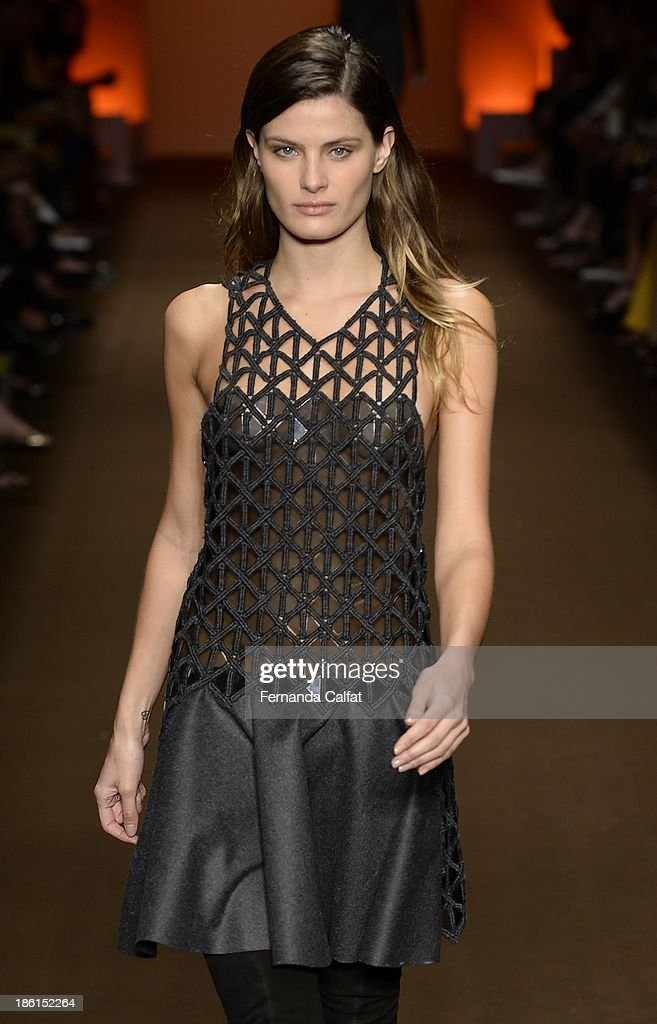 <a gi-track='captionPersonalityLinkClicked' href=/galleries/search?phrase=Isabeli+Fontana&family=editorial&specificpeople=220508 ng-click='$event.stopPropagation()'>Isabeli Fontana</a> walks the runway at Tufi Duek show at Sao Paulo Fashion Week Winter 2014 on October 28, 2013 in Sao Paulo, Brazil.