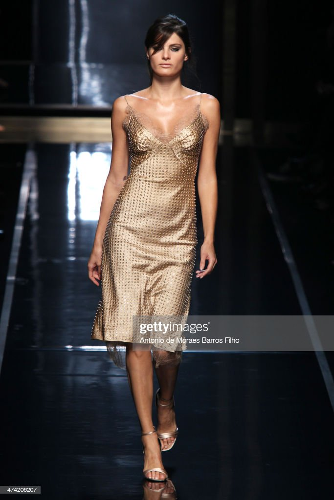 <a gi-track='captionPersonalityLinkClicked' href=/galleries/search?phrase=Isabeli+Fontana&family=editorial&specificpeople=220508 ng-click='$event.stopPropagation()'>Isabeli Fontana</a> walks the runway during the Ermanno Scervino show as a part of Milan Fashion Week Womenswear Autumn/Winter 2014 on February 22, 2014 in Milan, Italy.