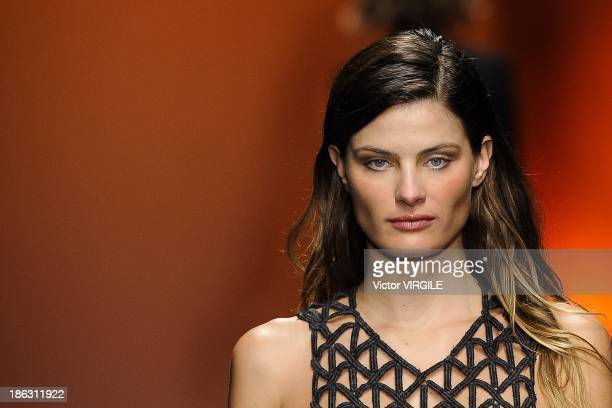 Isabeli Fontana walks the runway during the Tufi Duek show at the Sao Paulo Fashion Week Winter 2014 on October 28 2013 in Sao Paulo Brazil