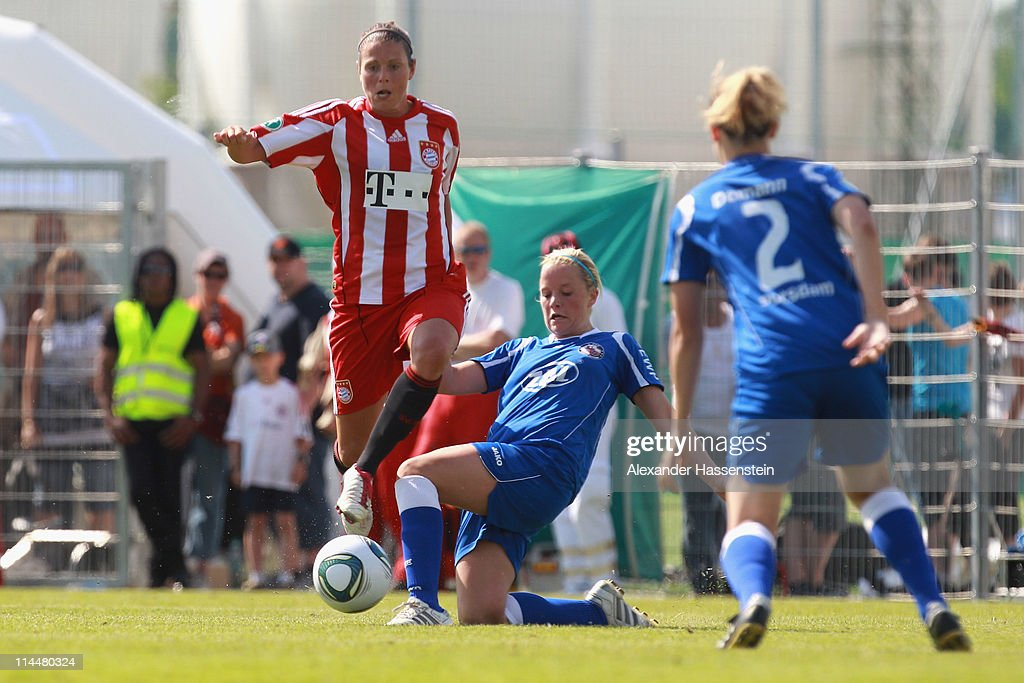 Isabell Bachor (L) of Muenchen battles for the ball with Jennifer Zietz (C) of Potsdam during the women Bundesliga Cup 2011 final match between FC Bayern Muenchen and 1.FFC Turbine Potsdam at Audi Sportpark on May 21, 2011 in Ingolstadt, Germany.