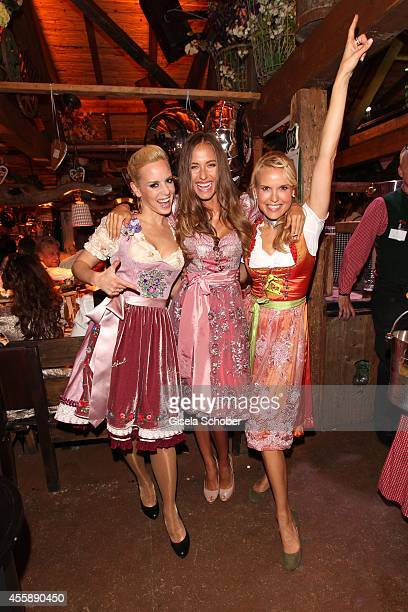 Isabell Edvardsson Alena Gerber Tamara Dobeleit attend the 'Almauftrieb' at Kaefer tent during Oktoberfest at Theresienwiese on September 21 2014 in...