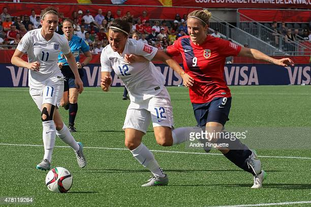 Isabell Herlovsen of Norway battles for the ball against Lucy Bronze and Jade Moore of England during the FIFA Women's World Cup Canada 2015 round of...