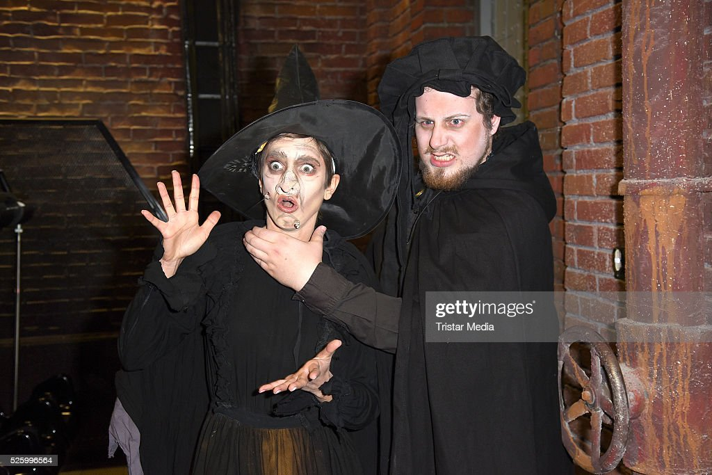 Isabell Horn as witch with a scary figure during the Isabell Horn Photo Call At Berlin Dungeon on April 29, 2016 in Berlin, Germany.
