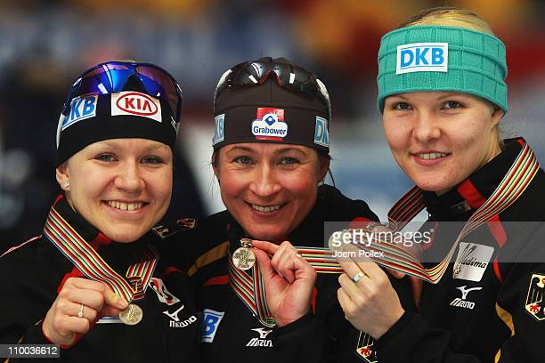 Isabell Ost Claudia Pechstein and Stepahie Beckert of Germany take place on the podium for third place of the womens Team Persuit race during Day 4...