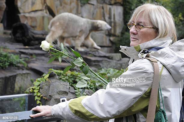 Isabell Steinkopf fan of Berlin zoo's superstar polar bear Knut lays a flower in front of Knut's enclosure at the zoo in Berlin on September 23 one...