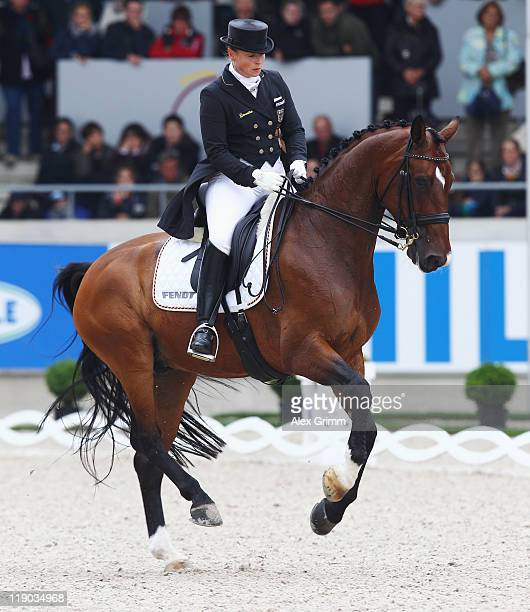 Isabell Werth of Germany performs on her horse El Santo during the 'Preis der Teschinkasso' dressage competition at the CHIO on July 14 2011 in...