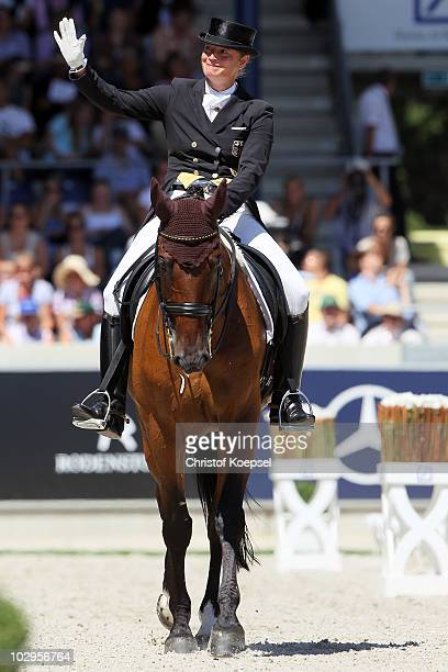Isabell Werth of Germany rides on Satchmo and celebrates her third place of the Dressage Grand Prix Freestyle CDIO competition of the CHIO on July 18...