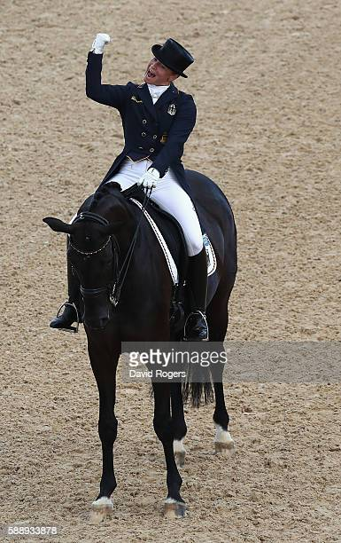Isabell Werth of Germany riding Weihegold Old celebrates as they win the team gold during the final day of the Dressage Grand Prix event on Day 7 of...