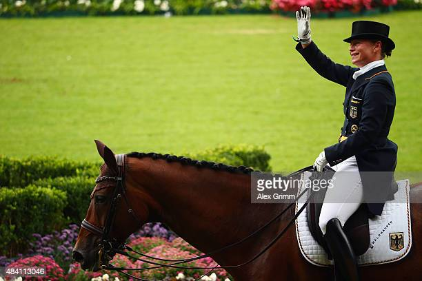 Isabell Werth of Germany waves on her horse Don Johnson FRH after competing in the Dressage Grand Prix Special Individual Final on Day 4 of the FEI...