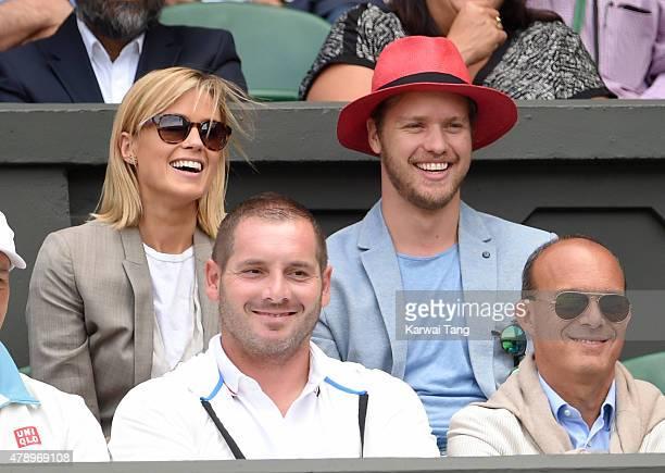 Isabella Calthorpe and Sam Branson attend the Philipp Kohlschreiber v Novak Djokovic match on day one of the Wimbledon Tennis Championships on June...