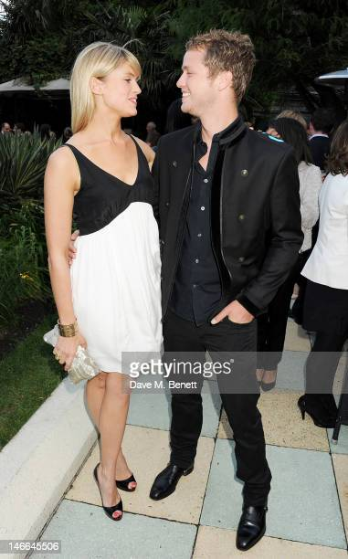 Isabella Calthorpe and Sam Branson attend the WTA PreWimbledon Party presented by Dubai Duty Free at Kensington Roof Gardens on June 21 2012 in...