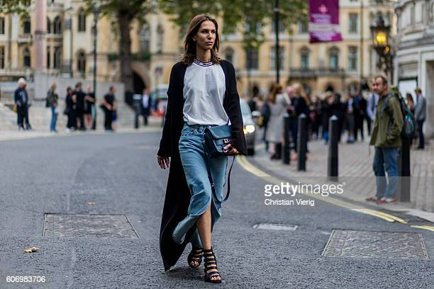 Isabella Charlotta Poppius wears Pyjama dressing gown coatAthleisure top by Palace SkateboardsMaxi denim skirt with slit by Topshop UniqueBag by...