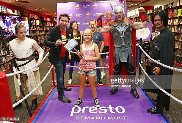 Isabella Gaunt celebrates after defeating a man in cosplay dressed as Thor as MC Jay Allen looks on during the first ever 'Rock Paper Scissors Lizard...