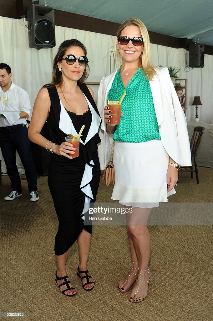 Isabella Giobbi and Rosanna Salles attend the ISSA London lunch celebrating British fashion and fashion illustration at the Tent at Soho Beach House on December 5, 2013 in Miami Beach, Florida.