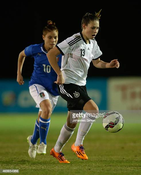 Isabella Hartig of Germany and Manuela Giugliano of Italy fight for the ball during the women's U19 international friendly match between Germany and...