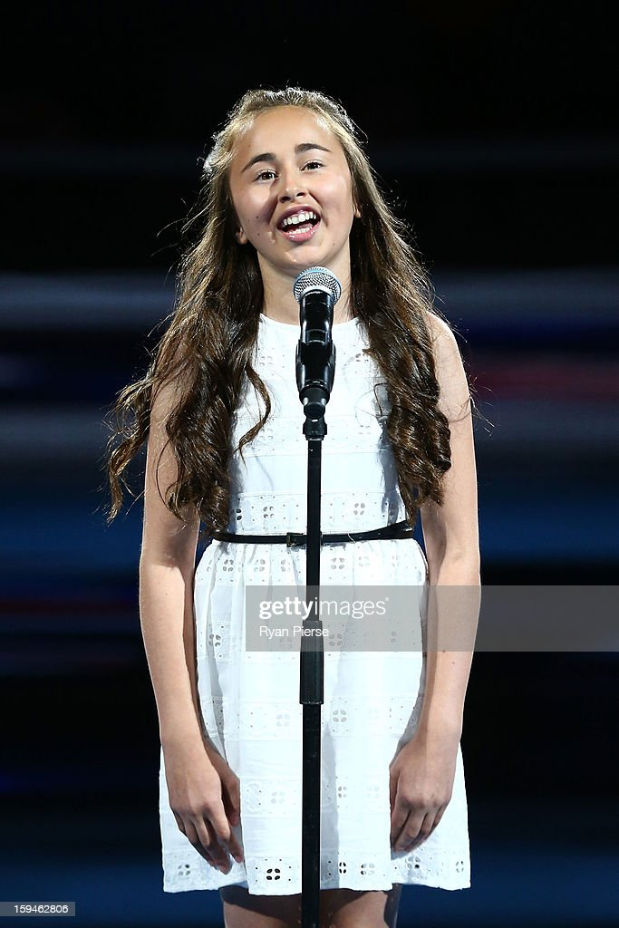 Isabella Mascia sings the national anthem during the opening ceremony on day one of the 2013 Australian Open at Melbourne Park on January 14, 2013 in Melbourne, Australia.