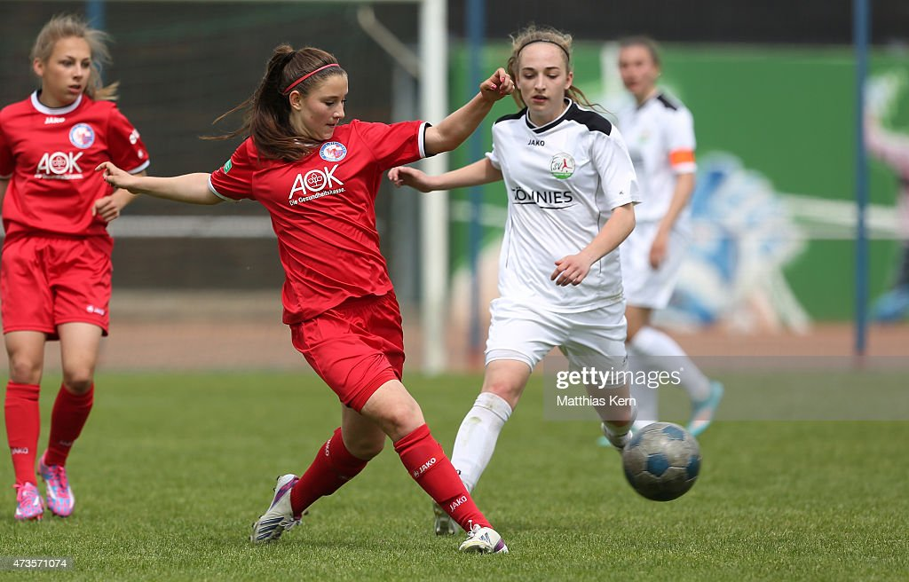 Isabella Moeller of Potsdam battles for the ball with Sophia Kleinherne of Guetersloh during the U17 Girl's Bundesliga semi final first leg match...