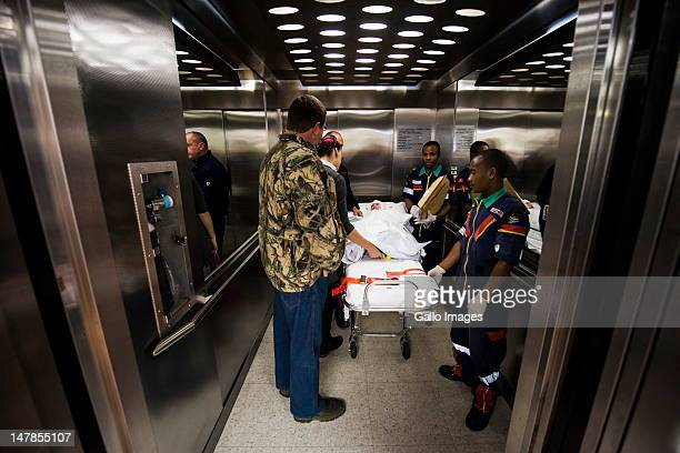 Isabella 'Pippie' Kruger is wheeled into an elevator as she prepares to be transferred to a rehabilitation clinic on July 4 2012 in Johannesburg...