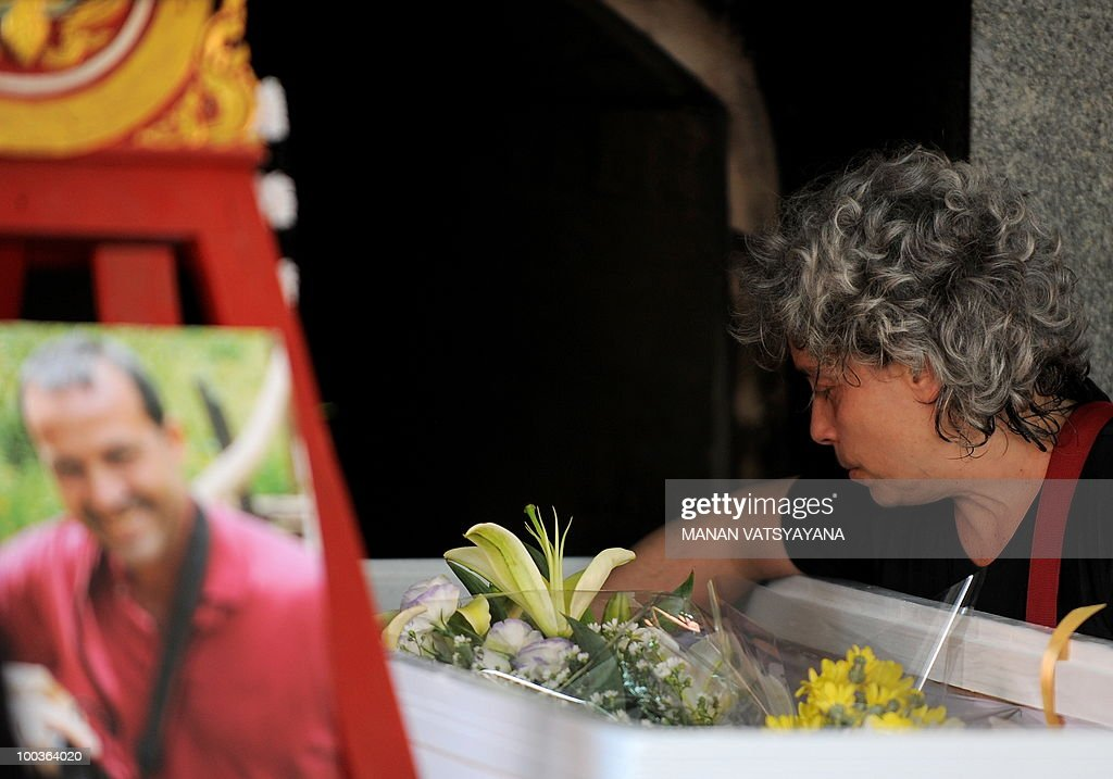 Isabella Polenghi, sister of slain Italian photograher Fabio Polenghi, pays her last respects at his funeral at a temple in Bangkok on May 24, 2010. Polenghi, a freelance photographer and documentary maker, was shot while covering the military offensive to close down long-running 'Red Shirts' demonstrations in the capital on May 19.