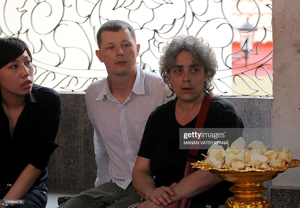 Isabella Polenghi (R), sister of slain Italian photograher Fabio Polenghi, attends his funeral at a temple in Bangkok on May 24, 2010. Polenghi, a freelance photographer and documentary maker, was shot while covering the military offensive to close down long-running 'Red Shirts' demonstrations in the capital on May 19.