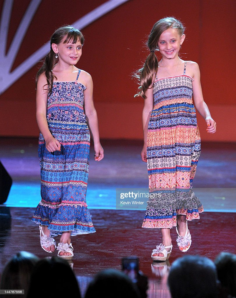 Isabella Rickel and Mariella Rickel walk onstage at the 19th Annual Race To Erase MS held at the Hyatt Regency Century Plaza on May 18, 2012 in Century City, California.