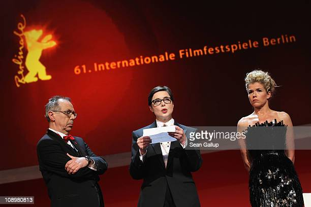 Isabella Rossellini reads a letter of Iranian director and jury member Jafar Panahi who is imprisoned in Iran next to Dieter Kosslick and Anke...