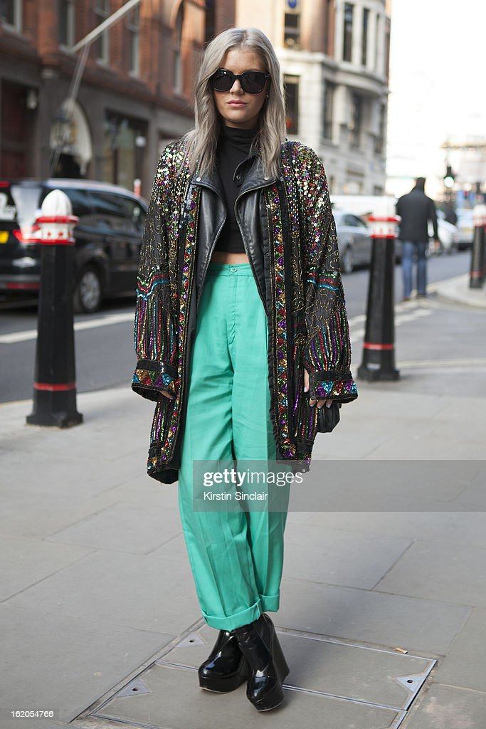 Isabella Thordsen wears Tom Ford glasses, ASOS top and shoes, vintage trousers and vintage sequin jacket on day 4 of London Womens Fashion Week Autumn/Winter 2013 on February 16, 2013 in London, England.