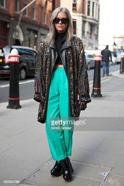 Isabella Thordsen wears Tom Ford glasses ASOS top and shoes vintage trousers and vintage sequin jacket on day 4 of London Womens Fashion Week...