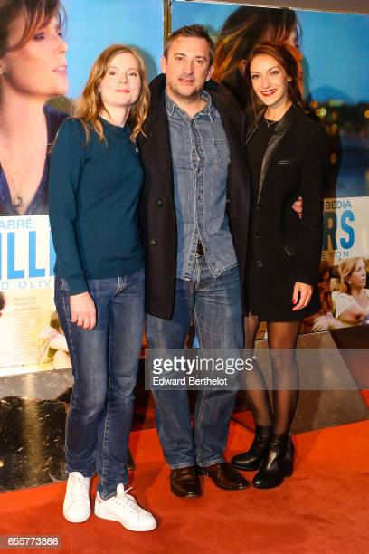 Isabelle Carre Olivier Peyon and Maria Duplaa attend the 'Une Vie Ailleurs' Paris Premiere at UGC Cine Cite des Halles on March 20 2017 in Paris...